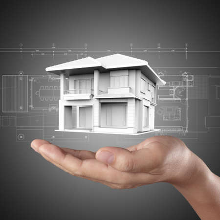 The house in hands on blue print Stock Photo - 14774913