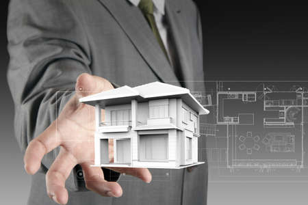 The house in hands on blue print Stock Photo - 14774798