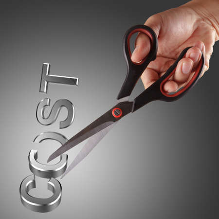 recession: Cutting costs with hand and scissor Stock Photo