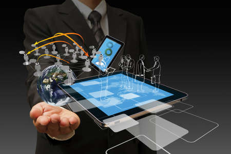 Technology in the hand of businessmen on dark background photo