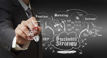 relationship strategy: business man writing business strategy concept