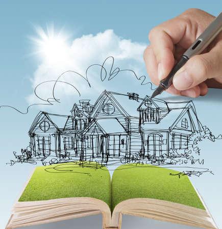 droomhuis: open boek van een droom huis met zonlicht blauwe hemel groen gras
