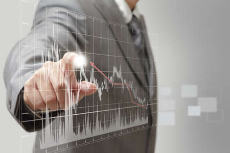 secure growth: a business man hand graph Stock Photo
