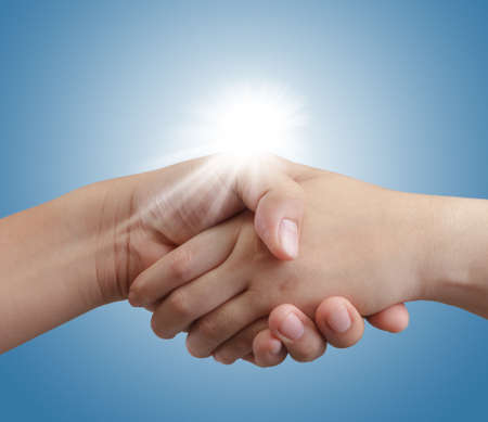 handshake on blue sky and sunlight background Stock Photo - 15069961