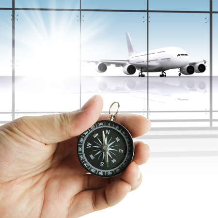 navigate: Hand holds the compass showing the right direction Stock Photo