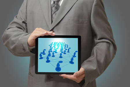 Modern people doing business, graphs and charts being demonstrated on the screen of a touch-pad Stock Photo - 15785972