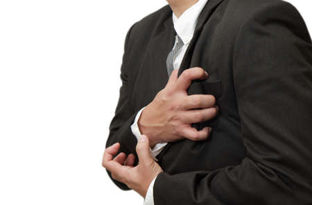 angina: Senior man having a heart attack isolated on white background