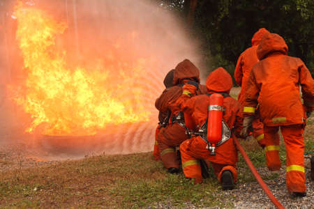 extinguish: Firefighters fighting fire during training
