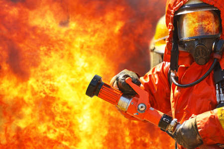 fire protection: Firefighters fighting fire during training