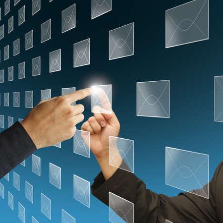 Young stylish businessman touching virtual interface button photo