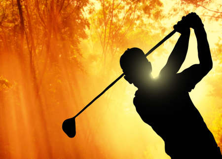 Golfer putting a ball on the green of a golf course Stock Photo - 16086689