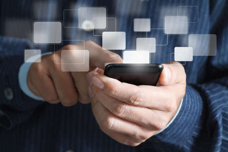 wireless: Touch screen mobile phone, in hand Stock Photo