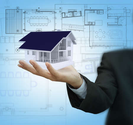 Businessman present house model and plan on touch screen photo