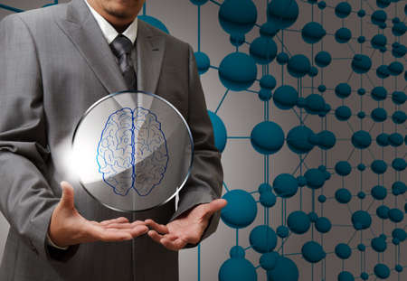 brain shape: business man hand show brain sign as medical technology Stock Photo