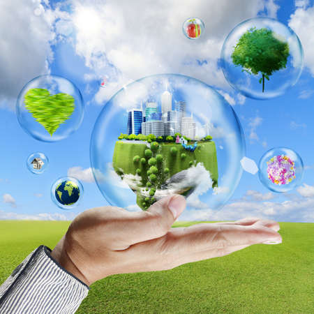hand holds bubbles with business collection inside as symbol of nature protection photo