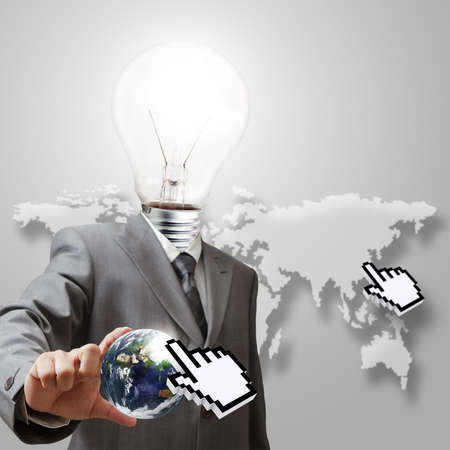 light bulb head business man hand shows globe and hand cursor internet conceptElements of this image furnished by NASA photo