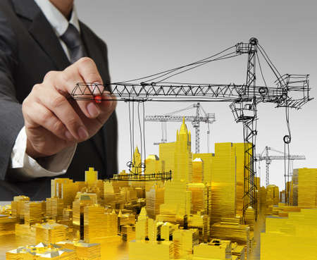 construction project: business man hand draws golden building development concept