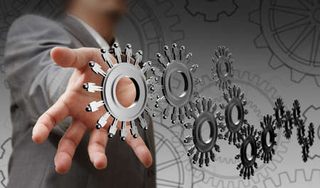 businessman hand shows people cogs as concept photo