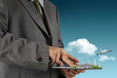 businessman hand holds touch pad as concept Stock Photo - 16081424