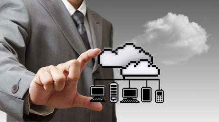 businessman hand picks 3d pixel cloud network icon as concept photo