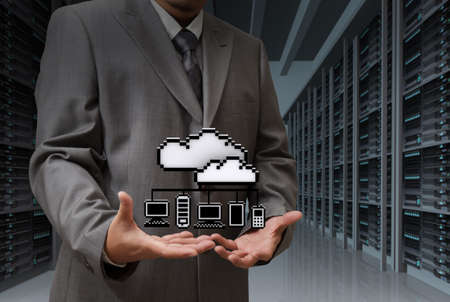 Businessman show cloud network icon on server room background photo