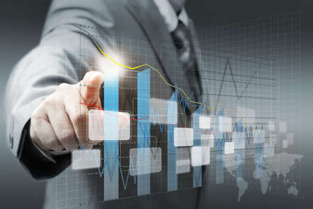 financial analysis: businessman hand touch virtual graph,chart, diagram Stock Photo