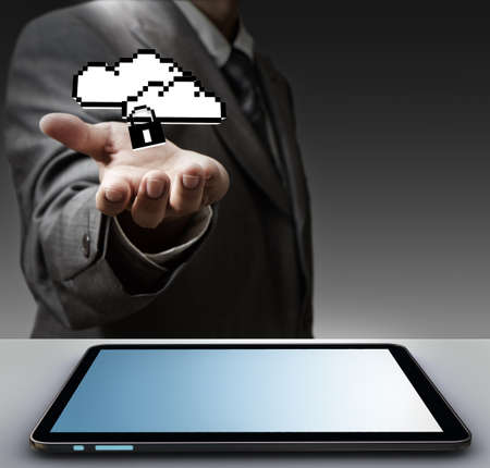 close up of hand holds tablet computer and pixel cloud network sign as concept photo