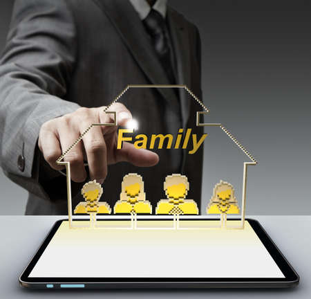 business man hand shows 3d family pixel icon and tablet computer as concept photo