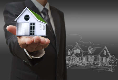 real estate background: businessman shows a house