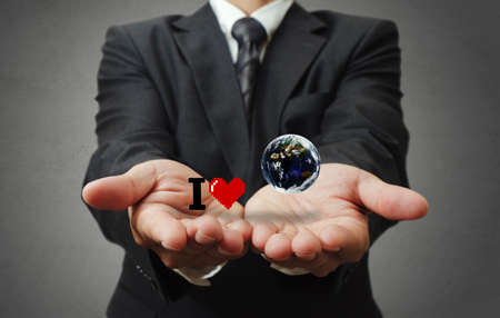 business man hand holds I love the earth as concept, elements of this image furnished by NASA Stock Photo - 16081132