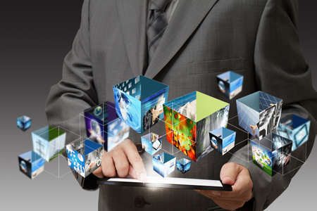 concept images: business hand holding a touch pad computer and 3d streaming images Stock Photo