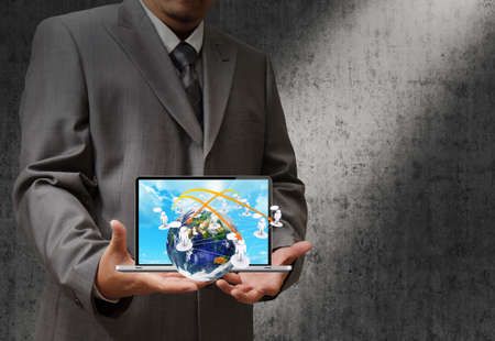 business hand holding a laptop computer and virtual social network sign photo
