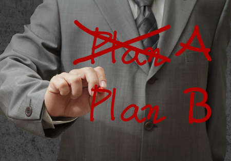 businessman hand drawing plan a plan b photo