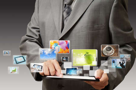 message pad: business hand shows touch screen mobile phone with streaming images Stock Photo