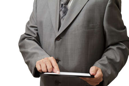 Handsome businessman using his digital tablet Stock Photo - 16097040