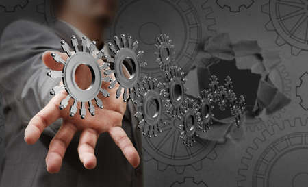 energy work: businessman hand shows people cogs as concept Stock Photo