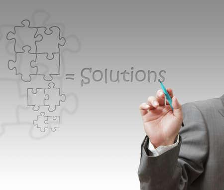 Businessman draws success puzzle photo