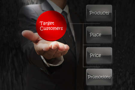 dirt background: businessman hand shows target customers diagram on dirt background Stock Photo