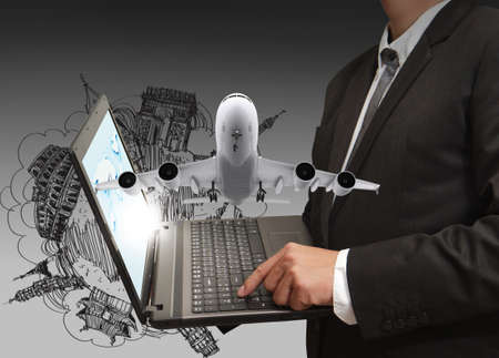 business man shows laptop and dream travel Stockfoto