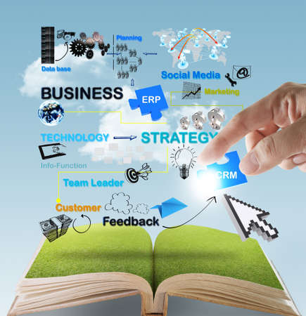 open book of hand point to business network diagram concept Archivio Fotografico