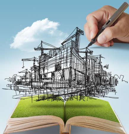 otevřená kniha z rukou kreslí na budovy a stavby