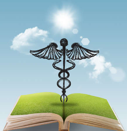 green medical sign: open book of hand drawn silhouette medical sign