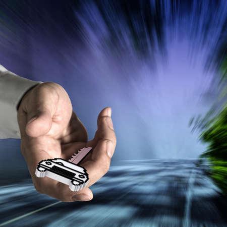 pr�s de la main offre pixel ic�ne repr�sentant une cl� de voiture et d'arri�re-plan flou comme concept photo