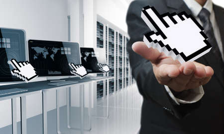 cursor hand: business man hand shows hand cursor in computer center room