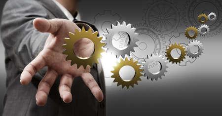Geschäftsmann Hand zeigt 3d metallic Zahnräder und Getriebe als Konzept