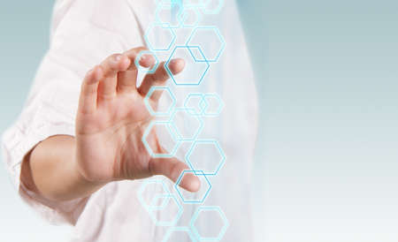 medical light: woman hand working on virtual technology interface as concept Stock Photo