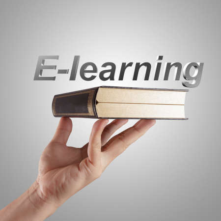 hand writing a e-learning word concept Stock Photo - 16096739
