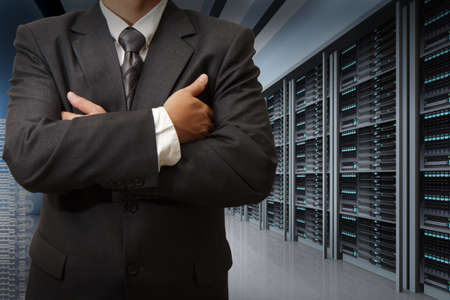 server rack: business man engineer in data center server room