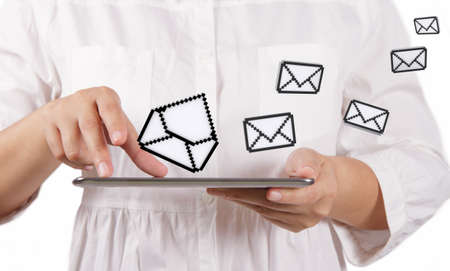 ringtones: business woman using tablet computer and email icons Stock Photo