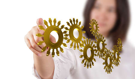 energy work: businesswoman hand and gold people cogs as concept